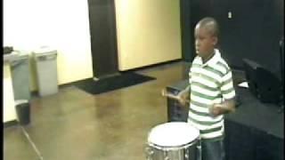 Makiah Jeremaine Martin on snare, drumset