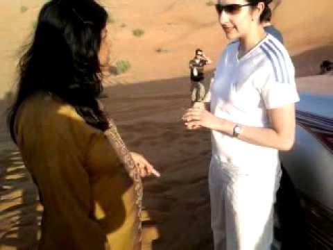 ....REKHA  IN DESERT SAFARI AT DUBAI...WITH A CO TRAVELLER TALKING ON LIFE ..!..