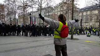 Peaceful French demonstrator being attacked by police at Gilets Jaunes (yellow vests) protests