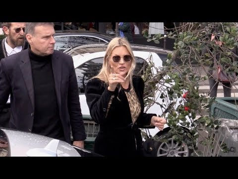 Kate Moss coming out of the Avenue restaurant in Paris