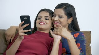Beautiful Indian girls in love sharing a romantic moment with each other at home