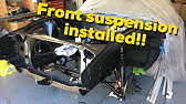 Front suspension gets installed on the Datsun 240z