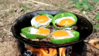 Survival skills: Chicken eggs in peppers grilled on clay for food - Cooking eggs eating delicious