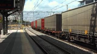 Comsa Rail Transport - 335.021 con tren papelero con vagones madereros en Fuente de la Mora