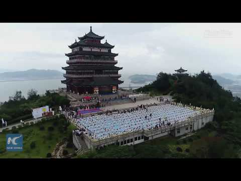 Over 1,000 Chinese practice yoga together to mark International Yoga Day