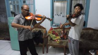 young violinist Rifky adriansyah arif with his father duet