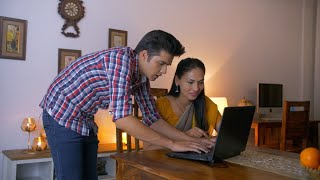 Smart Indian boy teaching his mother how to use the laptop - Family bonding, Technology Use