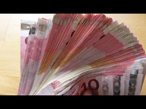 Counting Stack Of 10 EURO Banknotes