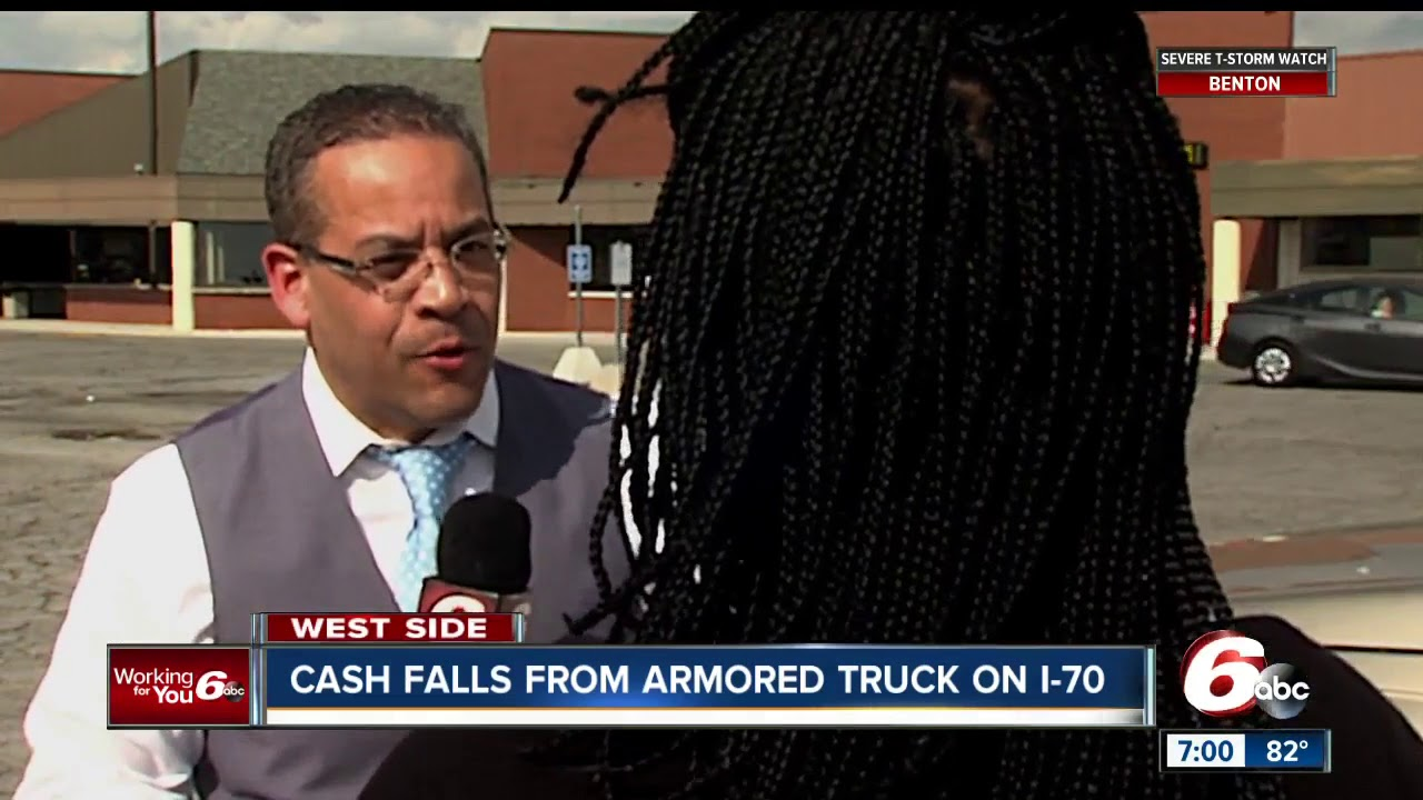 Woman describes scene along Indy highway after armored truck loses bags full of cash