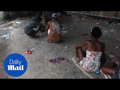 Inside Crackland, Rio's squalid open air drug market - Daily Mail