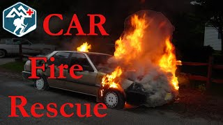 Woman Pulled From Burning Car