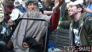 Anonymous Gives Money, Food to Homeless Man at Million Mask March