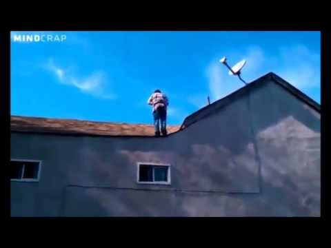 Must See Popular Videos | What's Good - Crazy Guy Does Back Flip Off 40-Foot Roof