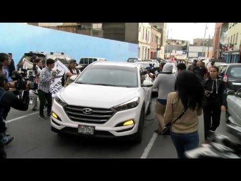 Car driving Peru's Keiko Fujimori arrives at police facilities