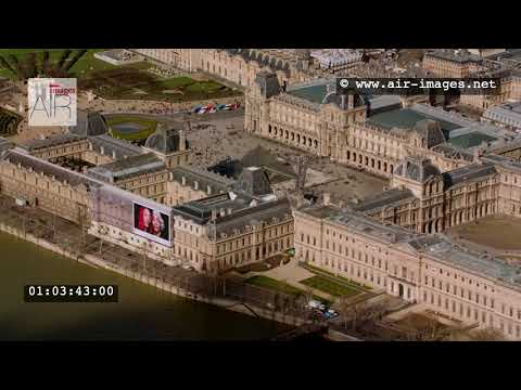 Aerial Footage Paris The Louvre Museum and the river Seine / The Invalides