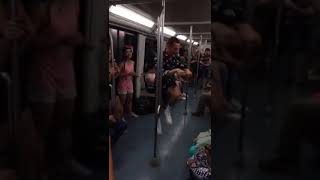 Subway creatures  guy blue button up shirt white shoes dancing on subway train
