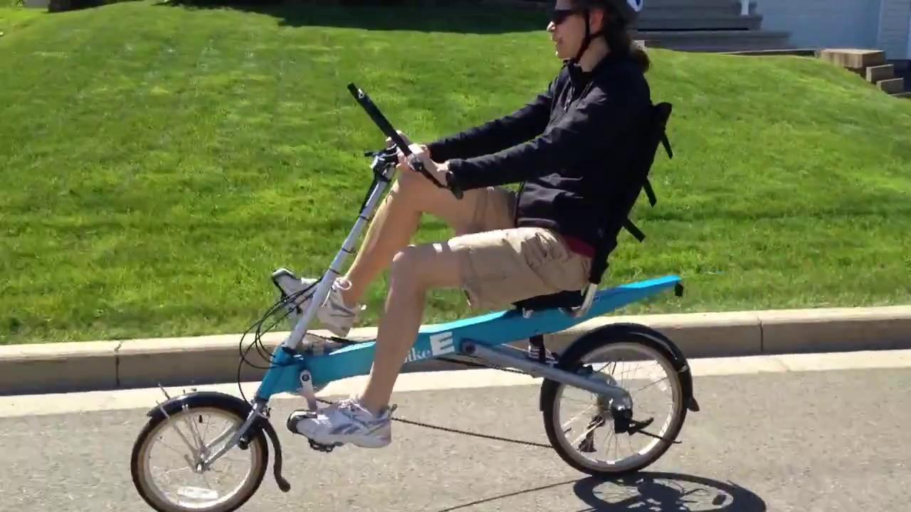 BEAUTIFUL WOMAN RIDING BIKE E RECUMBENT BIKE BICYCLE