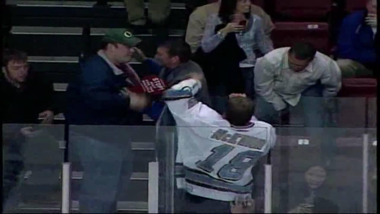 crazy hockey player vs fan