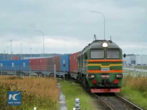 Cargo train carries parallel car imports from Europe to China