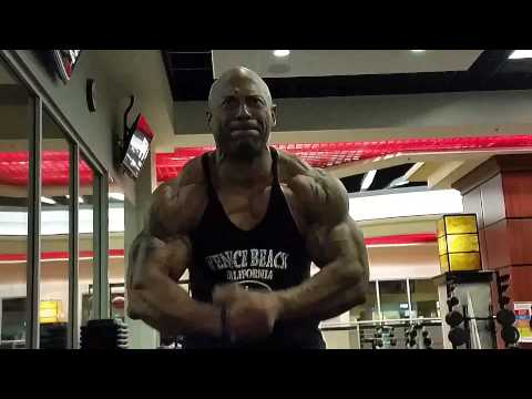 BODYBUILDER CARL MATTHEWS,  arms with big E