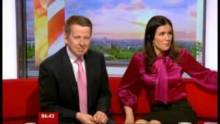 Susanna Reid red satin bow blouse