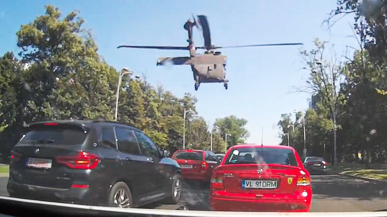 Helicopter Lands In Heavy Traffic