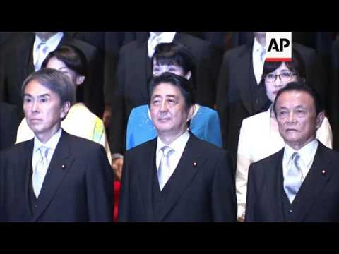 Abe unveils new Japan cabinet after reshuffle