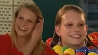 Cute German girls take an unexpected dip in the swimming pool