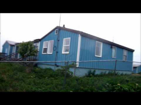 Driving through the fishing village of Pilot Point, Alaska