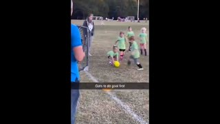 Little Goalie Girl Picks Up The Ball And Throws It Into The Soccer Net