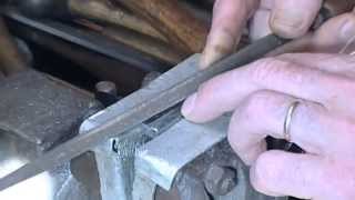 Hand cutting a small 'V' groove