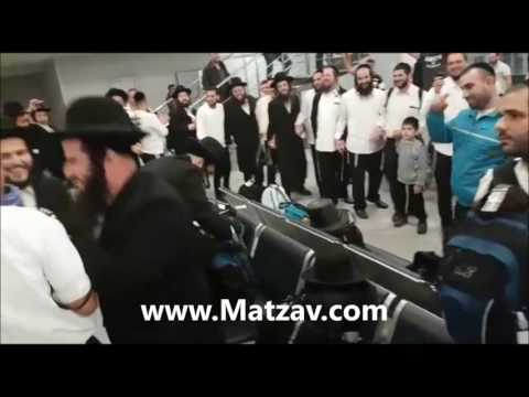 Airport Employee Rejoices with Uman Visitors
