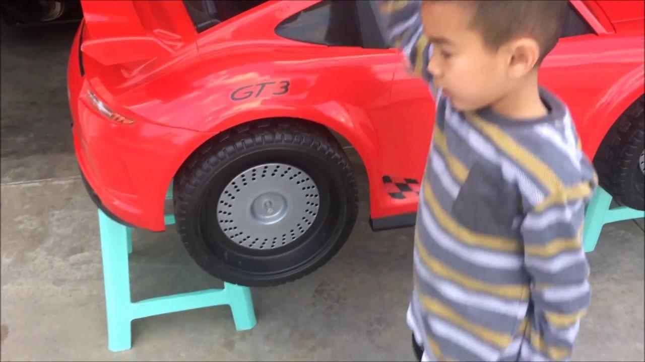 2JC Kid's Garage (7) Applying Flex Seal to the Wheels of a 24V Porsche 911  GT3 Power Wheels