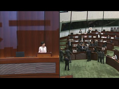 AFP news agency: Hong Kong leader abandons policy speech after heckling from lawmakers | AFP
