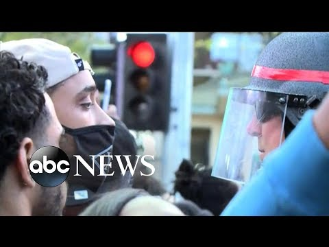 Demonstrators march to protest police shooting of unarmed man
