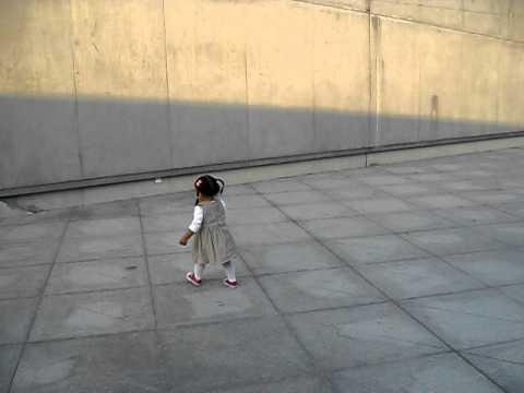 MVI 8759 Olivia dancing next to Opera house in HaiXinSha Asia Games Park
