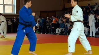 Athletes judoists fight in competitions