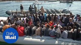 Libyan coast guards rescue 150 migrants en route to Europe - Daily Mail