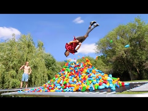 TRAMPOLINE VS 10,000 GIANT LEGOS!