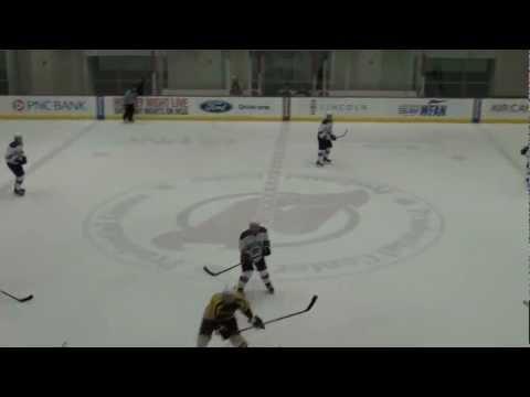 Slava throws a body check against Stevens University player