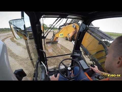 Liebherr A918 Wheeled Excavator Moving Mud - Cab View