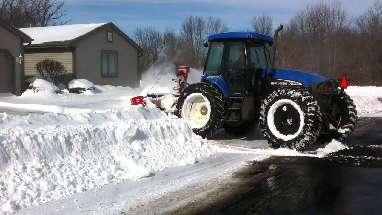 bi directional new holland tractor with pronovost pxpl snow blower