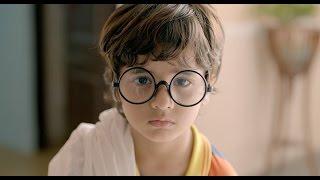 Cute little boy imitates Gandhiji.