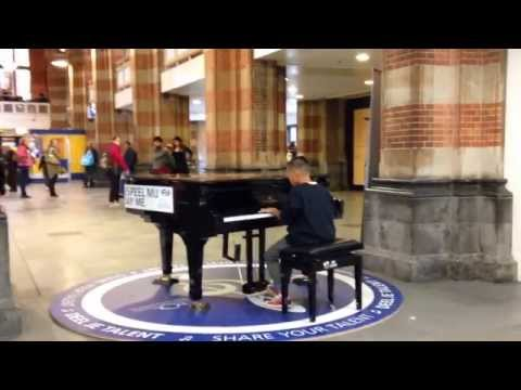 10 year old kid plays piano instrumental version 'Let it go' Frozen NS Amsterdam Central Station