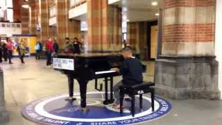 "10 year old kid plays piano instrumental version ""Let it go"" Frozen NS Amsterdam Central Station"
