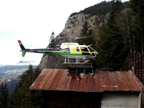 Heli Gotthard Ecureuil As 350 B3 Landing At The Roof Of A