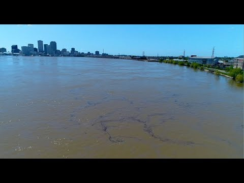 Watch oil spill slide by New Orleans on the Mississippi River: drone video