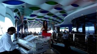 The Burj al Arab Dubai , Mutaha restaurant,Liza sings in a red dress on a whith piano