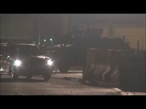 Bahrain : Riot Police Trying So Hard To Clean The APC Front Windows From Paints