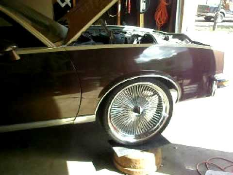 1978 Pontiac Grand Prix sitting on 22'' 180 Spoke Wire Wheels